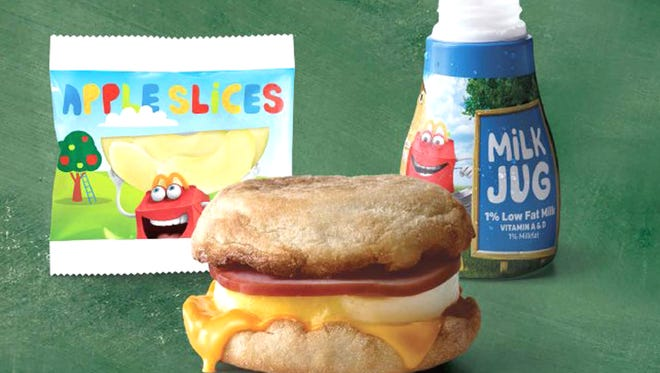 The free breakfast can include an Egg McMuffin, apple slices and milk.