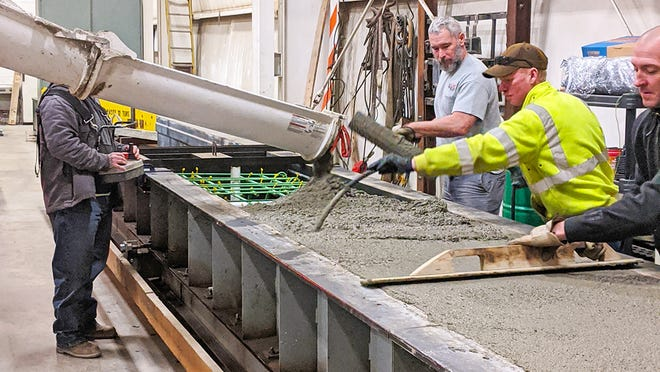 Wayne County Engineer's Office bridge crew pours bridge beams during the winter months. Concrete samples are then sent to a lab for testing before they are used in bridge construction the following summer.