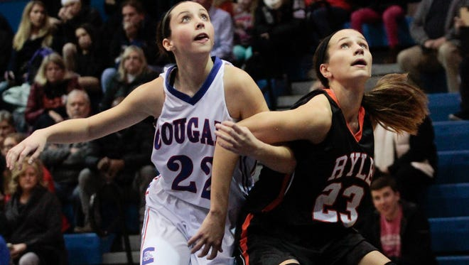 Maddie Scherr of Ryle tries to box out Maddie Burcham of Conner on a foul shot on Friday, Dec. 16.
