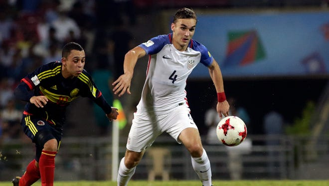 U.S player James Sands duels for the ball against Colombia's Brayan Gomez during the FIFA U-17 World Cup.
