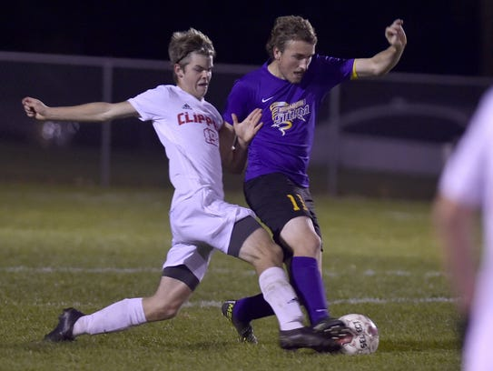Owen Stevenson of Sturgeon Bay, left, battles for control