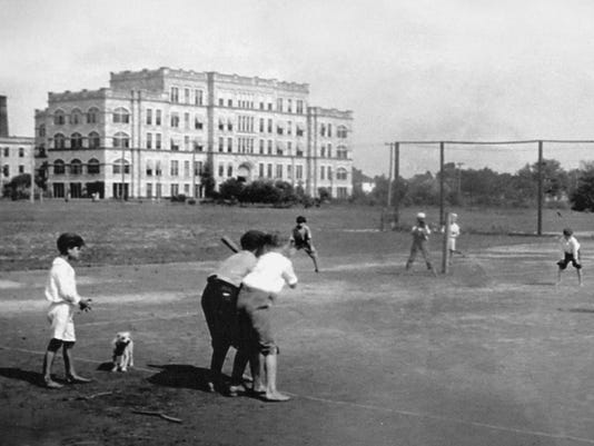 Kids playing baseball in front of 12th Ave hospital