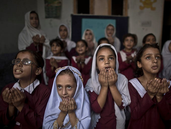 Schoolchildren chant prayers during a special class commemorating the one-year anniversary of the shooting of Malala Yousafzai on Oct. 9 at a school in Rawalpindi, Pakistan. One year after a Taliban bullet tried to silence Malala's demand for education, she has published a book and is a contender for the Nobel Peace Prize.