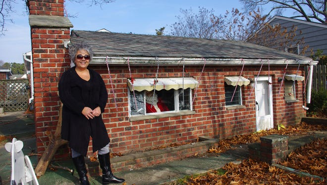 Anna Jones stands outside the tiny house in Brick. Photo Credit: ©Weird NJ / Mark Moran