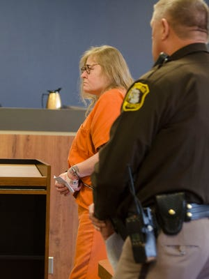Judy Higley-Zuehlke is directed to leave the courtroom Thursday, Feb. 23 after her sentencing in the second-degree murder of John Allen.