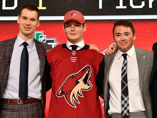 Barrett Hayton poses after being selected fifth overall by the Coyotes in the NHL draft on Friday.