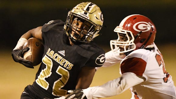 Greer's Dre Williams (22) springs free from Greenville's