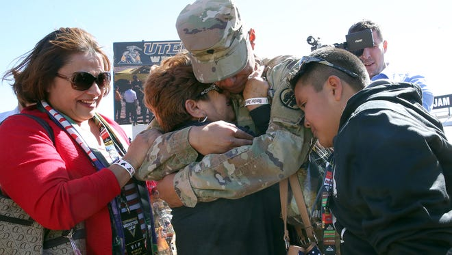 Spc. Pedro Ceijas, Jr., center, is greeted by mother, Norma Ceijas, left, aunt Vicky Beltran, center, and brother Trigo Ceijas, 11, with other relatives on the floor of the Sun Bowl Stadium at the start of Monster Jam event Sunday. Ceijas, 20, of the 83rd Military Police Company of the Army Reserve surprised his family after being away on deployment to Kuwait and Iraq the past nine months. As Monster Jam fans, Ceijas knew the family would be there and ran out to greet them after they were introduced as VIP fans of the event. Following the reunion, the family was escorted to the stands to watch the show.