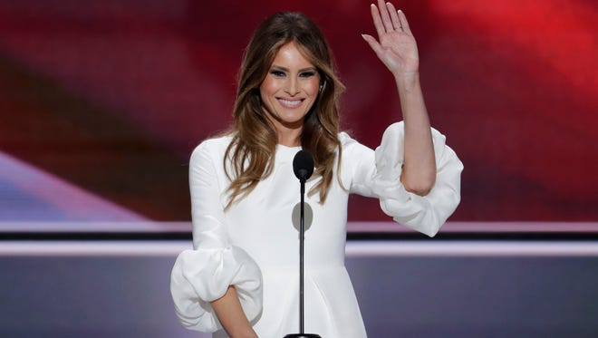 Melania Trump, wife of Republican Presidential Candidate Donald Trump waves as she speaks during the opening day of the Republican National Convention in Cleveland, Monday, July 18, 2016.