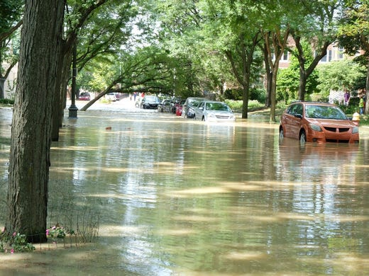 The Water Filled Cobblestone Street And Flooded