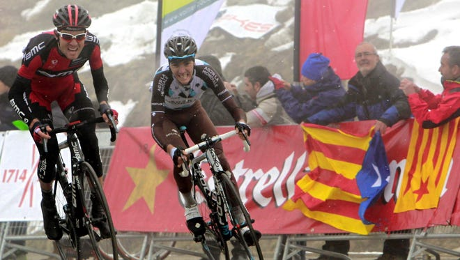 U.S. cyclist Tejay Van Garderen (L) of BMC team on his way to a win followed by French Romanin Bardet (R) of AG2R during the fourth stage of the Volta Ciclista a Catalunya in Catalonia, Spain, on Thursday.