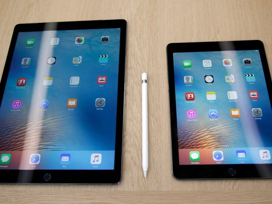 The new iPad pro, at right, is seen next to an older
