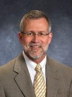 Outgoing principal David Peter