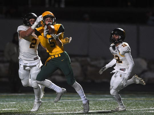 Bishop Manogue's Jack Masterson (5) hauls in a long pass while taking on Galena during their football game in Reno on Oct. 20.
