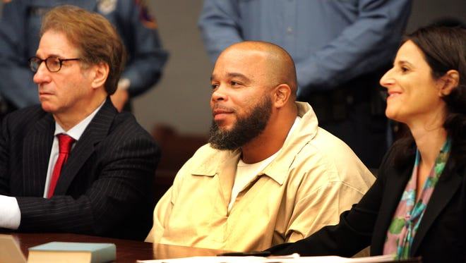 Gerard Richardson, center, along with his lawyer, Vanessa Potkin of the national Innocence Project, smile Oct. 28, 2013, as they listen to Judge Julie Marino of Somerset County, N.J., Superior Court talk about new DNA evidence that proves Richardson did not commit the murder he was convicted of in 1995. Also there was Barry Scheck, left, who founded the Innocence Project.