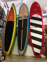 Try your hand at stand-up paddle boarding this summer.