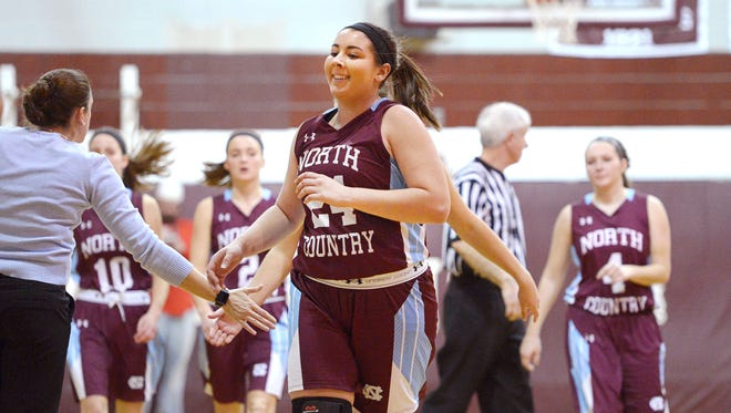 North Country's Kylie Wright reacts after scoring her 1,000th career point during the first quarter of a game at Lyndon Institute on Saturday.