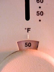 A home thermostat basks in late-afternoon sunlight.