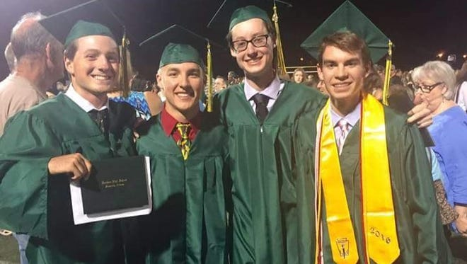 """From left, Daniel """"DJ"""" Purcell, Joseph Smith, Kevin Hurley and Matthew West at their graduation from Horizon High School in 2016. Smith died in a car accident Friday, June 17, 2016, that injured the three others."""