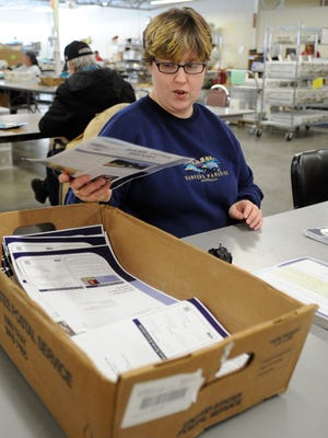 Jamie Fischer works Monday at the Opportunity Development Centers Inc. in Wisconsin Rapids.