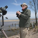 Charles Sontag of Manitowoc scans the Lake Michigan shoreline and an impoundment area along the lakefront in Manitowoc. Sontag was one of the first to identify the white-winged tern. That species had not been seen in Wisconsin since 1873.