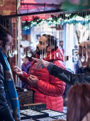 Shoppers browse at Union Square Holiday Market.