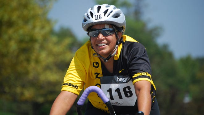 Aggie Acosta Flores, of Newark, rides in a biking event to raise money to fight cancer. The annual event will be held near Baltimore this weekend.