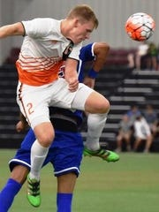 Bucks defender Brad Ruhaak (top) gets to the ball first in the PDL Final Four match against the Midland/Odessa Sockers.