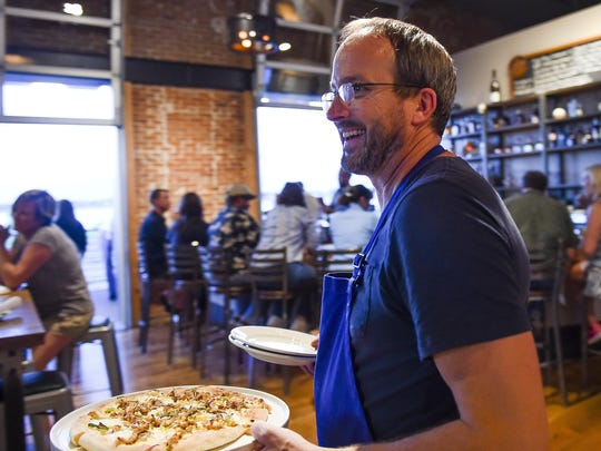 Chef Jason Shaeffer serves up food during opening night at Hearth Restaurant and Pub in 2015.