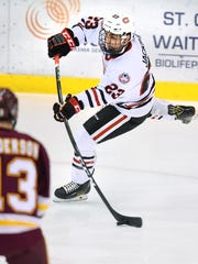 St. Cloud State's Robby Jackson slaps the puck in to score against the University of Minnesota-Duluth 53-seconds into the first period Saturday, Nov. 5, at the Herb Brooks National Hockey Center.