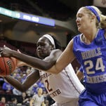 Florida State's Adut Bulgak (2) and Middle Tennessee's Rebecca Reuter (24) reach for a rebound during the first half of a first-round Women's NCAA Tournament Saturday in College Station, Texas.