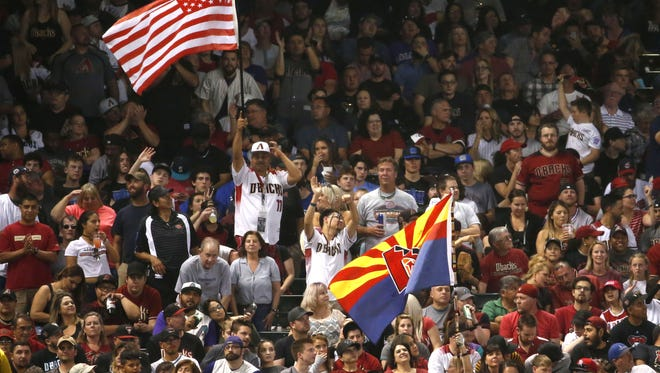 Arizona Diamondbacks fans cheer during opening day against the Colorado Rockies at Chase Field in Phoenix on March 29, 2018.