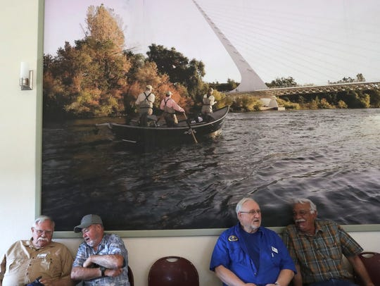 Shasta Trinity Fly Fishers members John Leslie, from left, Ralph Lestarjette, Bill Lenheim, and Mike Donaghy chat before the grand opening of the Clubhouse at the Clover Creek Preserve in Redding.