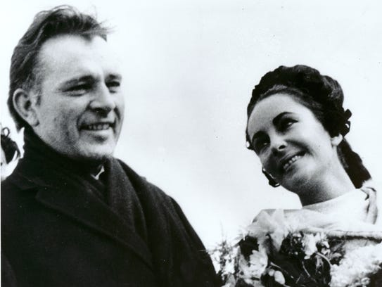 Newlyweds Elizabeth Taylor and Richard Burton are shown