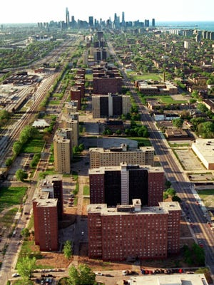 Two miles of 16-story towers, including the Robert Taylor homes in the foreground, with more than 4,300 apartments stretch toward the Chicago skyline in this May 31, 1996 file photo. Taylor, along with four other projects on the city's South Side, was part of a stretch once considered the highest concentration of poor people in America.