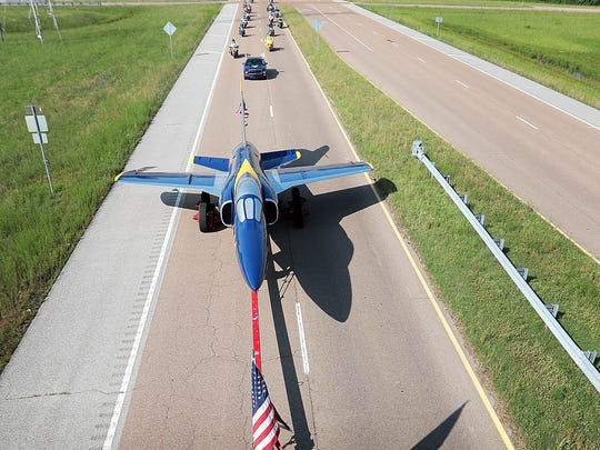 Millington's Blue Angel which has greeted visitors to the Navy Base since 1975, returns to it's home at the Millington airport via Singleton Parkway after the completion of a paint and restoration project at a Memphis auto body shop.