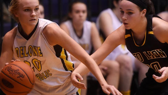 Delone CatholicÕs Katie Laughman, left, puts an arm