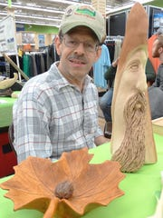 Hopatcong resident Ira Lichtman, a member of the Jersey Hills Wood Carvers club, displays his handiwork.