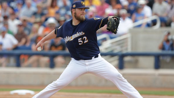 Brewers starting pitcher Jimmy Nelson works in the