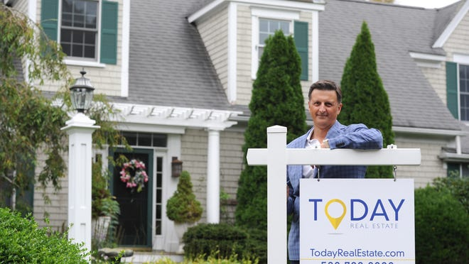 """Today Real Estate President Todd Machnik stands in front of a property at 222 Pine St. in Centerville, one of the company's listings. Machnik attributes a lot of the recent interest in Cape real estate to people who can now work remotely. """"Is it going to translate to an immediate increase in the year-round population? It's too early to tell,"""" he said."""