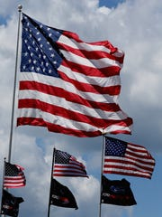 American flags wave during practice for the NASCAR