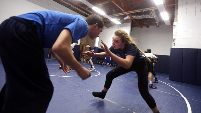 Natasha Greeve works out with teammate Daniel Reynolds. Greeve used to be Chatham's wrestling statistician, now, a senior, she is a rookie wrestler at 138 pounds. January 12, 2017, Chatham, NJ.