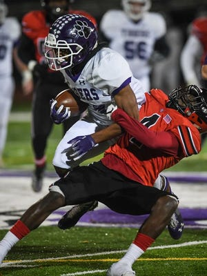 Pickerington Central's Nick Mosley looks to get by Groveport's Elyjah Aekins during the Division I, Region 3 final last season. The teams meet again Friday, Sept. 18, at Groveport.