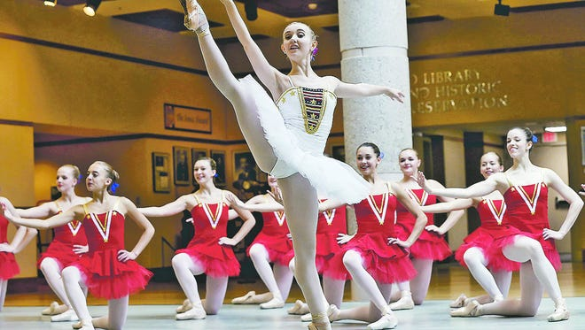 """Eleanor Albaugh, 20, of West Des Moines has a leading role in """"Stars and Stripes"""" in Ballet Des Moines' """"3 plus One: A Triple Bill."""" The company previewed the show earlier this month at the State Historical Museum."""