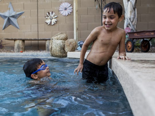 Zachary (left) and Grant Thompson, 5, plays in the