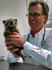Dr. Randy Eisel of Animalife Veterinary Center checks