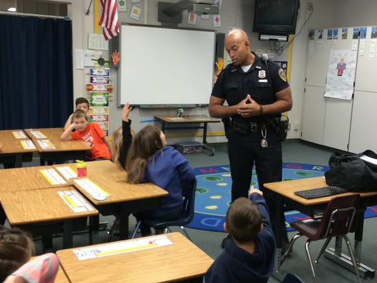 Officer Tim Davis discusses trick-or-treat safety with