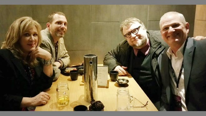 Donna Kishbaugh, Parker Lyons (second from left) and Greg Kishbaugh (right) have gotten to know filmmaker Guillermo del Toro as they run a fan site dedicated to him and his work.