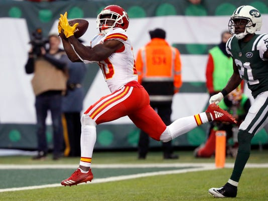 Kansas City Chiefs' Tyreek Hill, left, scores a touchdown during the second half of an NFL football game against the New York Jets, Sunday, Dec. 3, 2017, in East Rutherford, N.J. (AP Photo/Julie Jacobson)
