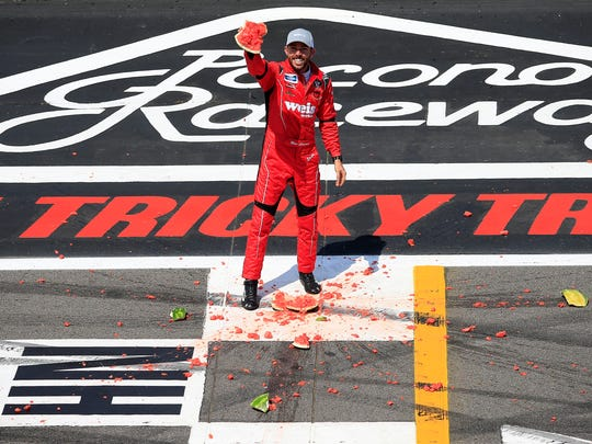 Ross Chastain celebrates by smashing a watermelon following his Truck Series victory at Pocono. (Chris Trotman/Getty Images)